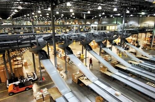 Row of conveyors inside of a industrial manufacturing facility